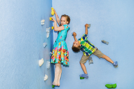 boy and girl playing in a childrens climbing wall