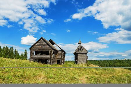 damaged roof: Old abandoned Russian village. The remains of the scenery constructed for a film about ancient Russia