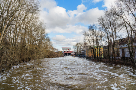 The spring flood. The dam on the river Tagil. Ural, Russia Stock Photo