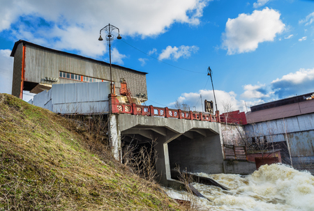 spillway: The spring flood. The dam on the river Tagil. Ural, Russia Stock Photo