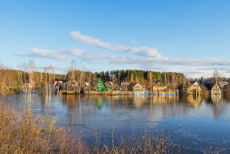 Natural disaster. Houses that were flooded as a result of spring floods Stock Photo