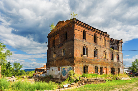 abandoned factory: STAROUTKINSK, RUSSIA - AUGUST 7, 2016: the ruins of the old metallurgical plant not the UTKA river, built in 1729 and belonged to the Akinfiy Demidov