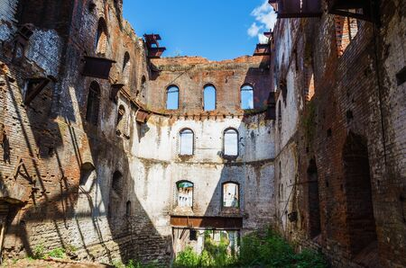 STAROUTKINSK, RUSSIA - AUGUST 7, 2016: the ruins of the old metallurgical plant not the UTKA river, built in 1729 and belonged to the Akinfiy Demidov