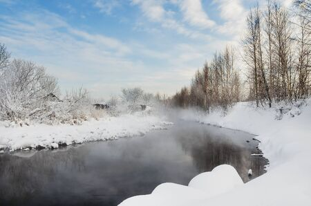 Fog over the river on a cold winter day Stock Photo