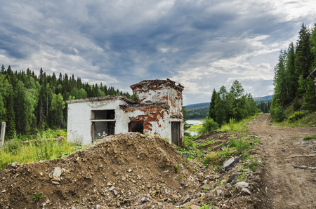 ruins of an abandoned building on the Bank of the Usva river. Russia, The Urals