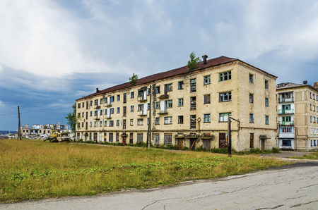 YUBILEYNY, PERM KRAI, RUSSIA - JULY 12, 2016: Abandoned building in the dead city on a summer day in cloudy weather
