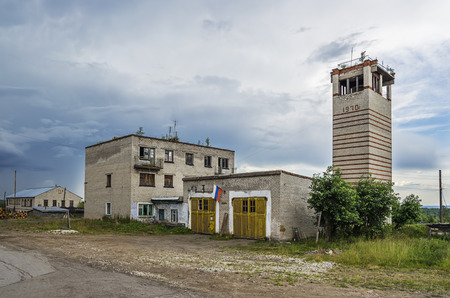 YUBILEYNY, PERM KRAI, RUSSIA - JULY 12, 2016:  building is abandoned firehouse in the summer cloudy day Stock Photo - 77360264