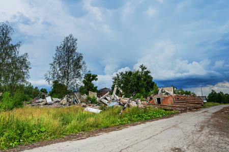 urals: The ruins of a multistory building in the abandoned town of Yubileyny on the background of dark cloudy sky. Russia, Perm Krai