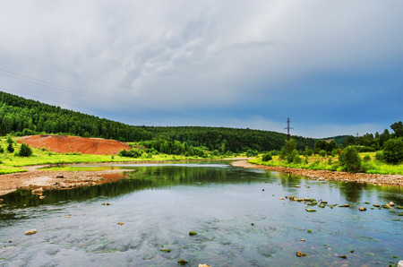 The view from the bridge over the river Usva on a cloudy day. Russia, Ural, Perm Krai