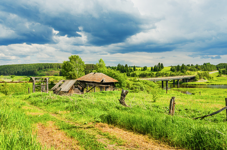 russian rural landscape abandoned destroyed old house on the