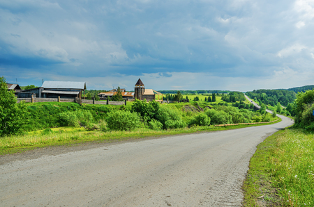 Russian rural landscape. The road is in a rural location