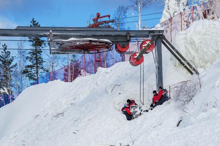 SVERDLOVSK REGION, RUSSIA - MARCH 2, 2018: A team of repairmen restores the ski lift.  Ski resort Mountain Ezhovaya Editorial