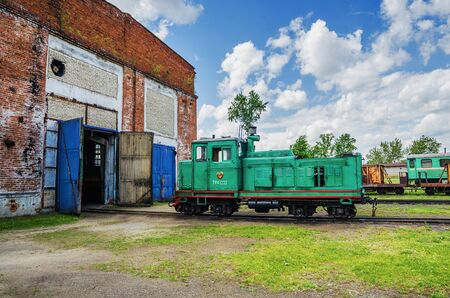 ALAPAYEVSK, RUSSIA - JUNE 15, 2017: TU4 diesel locomotive near the depot on the territory Head Office of the narrow-gauge railway is located in Alapayevsk, Sverdlovsk Oblast, Russia. In summer day