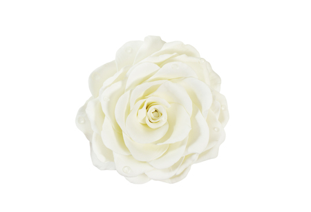 Artificial rose of  cream-colored color handmade, isolated on white background