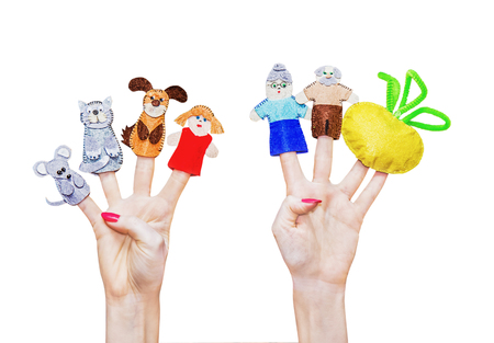Isolated female hands with fingers theatre puppets from the Russian folk tale turnip