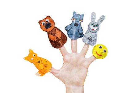 Isolated female hands with fingers theatre puppets from the Russian folk tale
