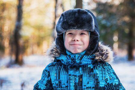Portrait of a boy on a winter walk. He smiles
