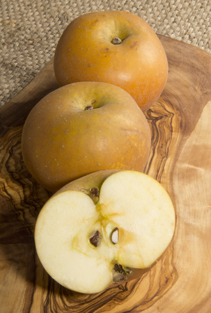russet: Russet apples on wood Stock Photo