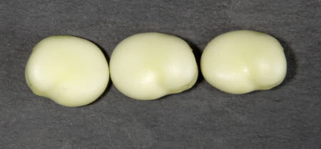 haba: Three Broad Beans on a Black Background