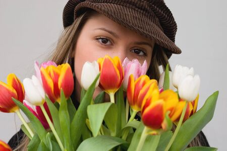 Girl with big eyes and a bouquet of tulips Stock Photo - 1067399