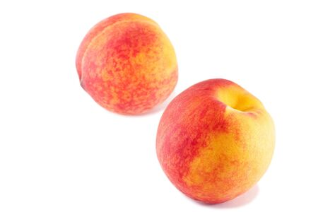 sweet segments: peaches isolated on white with small shadow