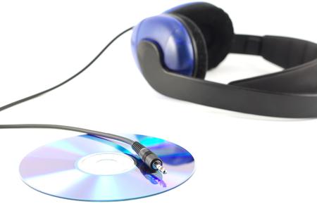 jackplug: headphones with cd and shiny jackplug isolated on white Stock Photo