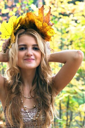 portrait of beautiful young girl in autumn park photo