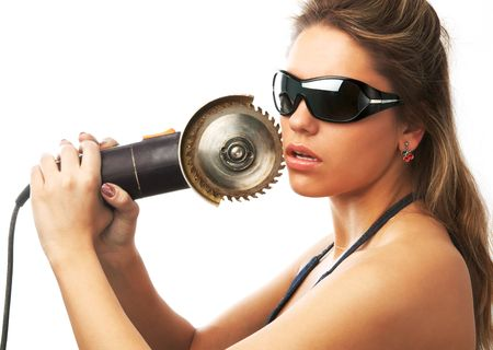 girl in sunglasses is holding circular saw near her cheek isolated on white photo