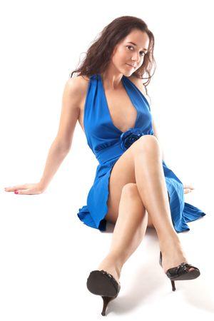 portrait of slender girl over white sitting in blue dress photo