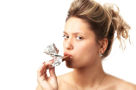 portrait of girl with brick of chocolate in foil isolated on white photo