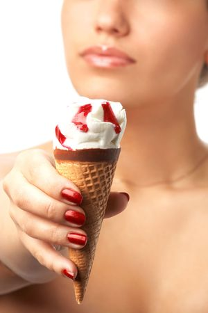 ice-cream cone in the foreground and beautiful naked (half-length portrait) unsharp girl in the background; isolated on white; shallow DOF Stock Photo - 3126368