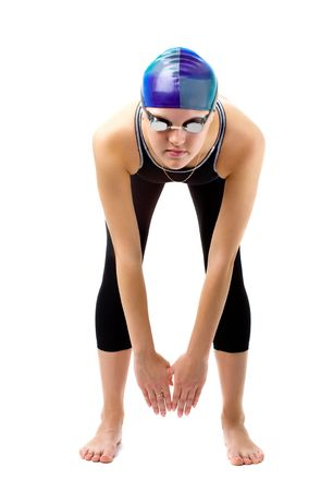 young beautiful swimmer girl in wet suit is starting isolated on white