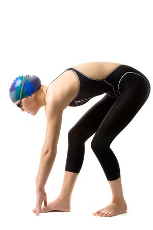girl swimmer in swimsuit is ready for a start. Stock Photo