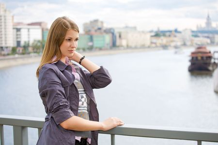 portrait of girl city and river on background photo