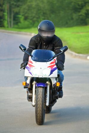 biker on sport bike in the movement photo