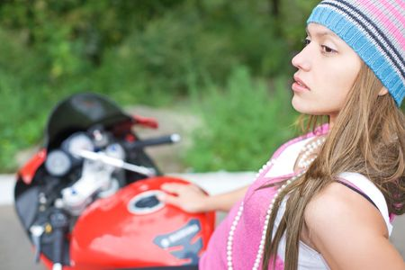 closeup portrait of young woman on motorcycle photo