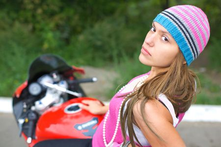 closeup portrait of girl on bike in the nature photo