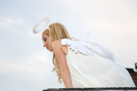angel is looking down from roof photo