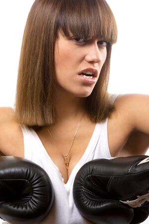 closeup portrait of aggressive girl with boxing gloves photo