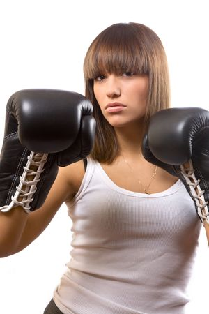 lace gloves: portrait of sexy brunette with boxing gloves over white Stock Photo