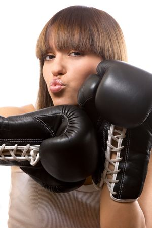portrait of sexy brunette with boxing gloves over white photo