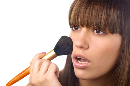 closeup portrait of beautiful girl with brush for makeup photo