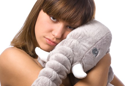 portrait of girl with soft toy (elephant) on white photo
