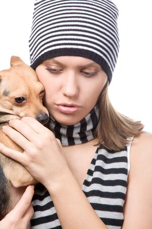 portrait of girl with doggy (toy-terrier) on white photo