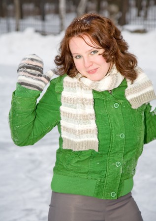 portrait of young woman in winter park photo