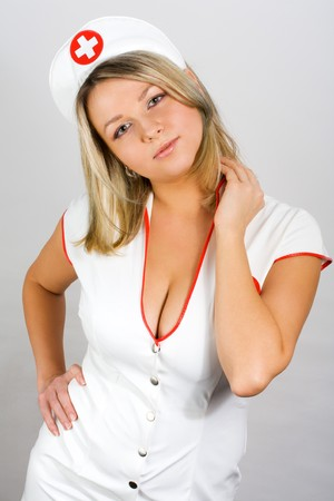 bosom: sexy young woman dressed as a nurse