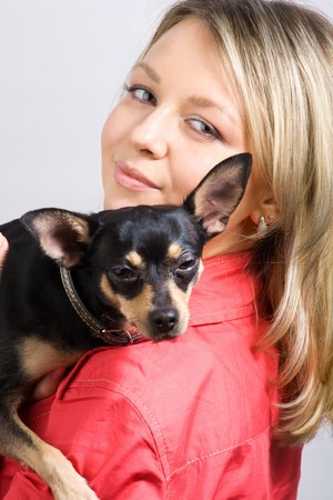 young woman is embracing small dog (toy-terrier) photo