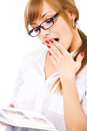 studing girl is yawning isolated on white photo