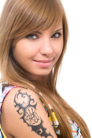 attractive woman with tattoo on hand photo