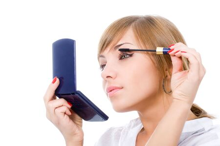 pretty young woman put mascara on eyelashes Stock Photo - 4769508